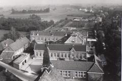 Datering 1965. Sint-Josephschool.-V.G.L.O-school-St.-Joseph-kleuterschool-H.-Bernadette-bejaardencentrum-St.-Petrus.